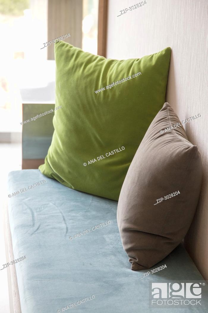 Stock Photo: Cushions in green and brown hotel indoor. Majorca, Balearic Islands, Spain.