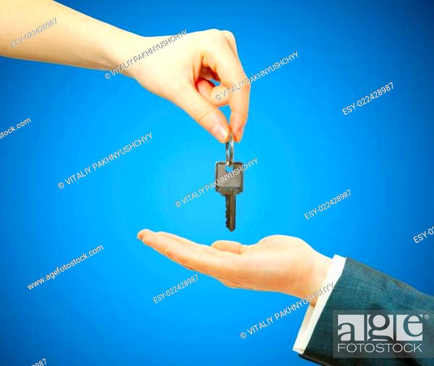 Stock Photo: hand holds a key.