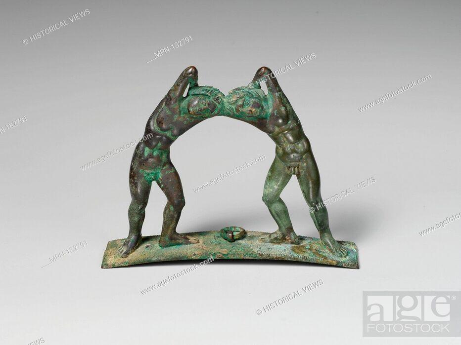 Stock Photo: Bronze handle from a cista (toiletries box). Period: Late Classical; Date: 4th century B.C; Culture: Praenestine; Medium: Bronze; Dimensions: H.
