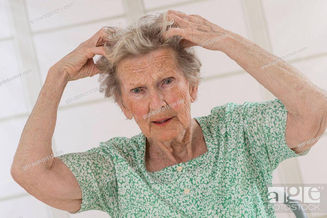 Stock Photo: Senior woman scratching herself.