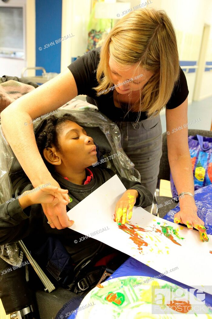 Stock Photo: Girl doing painting at Mysight charity for people with visual impairments, Nottingham.