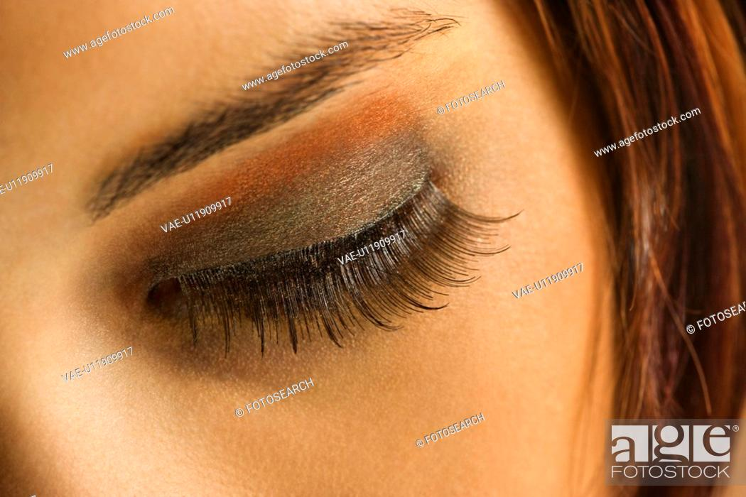 Stock Photo: Close up of young Caucasian woman's eye with makeup.