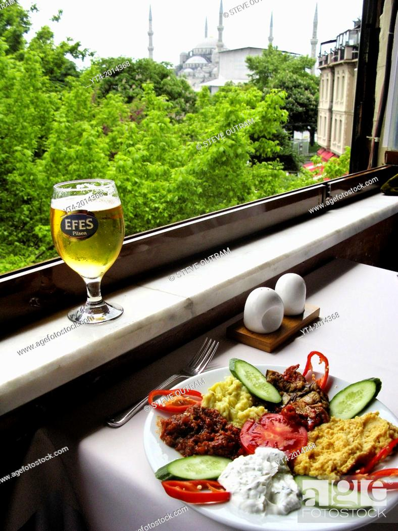 Stock Photo: Turkish Cuisine. Meze and Efes Beer. Omar Restaurant, Sultanahmet, Istanbul, Turkey.