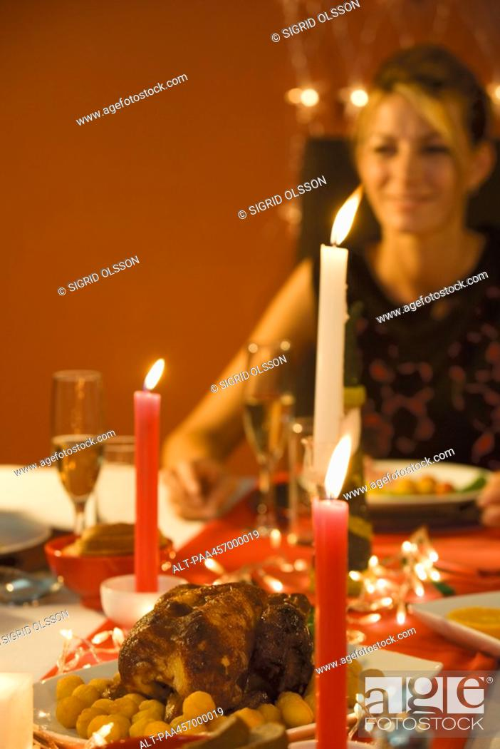 Stock Photo: Woman eating candle lit dinner, selective focus.
