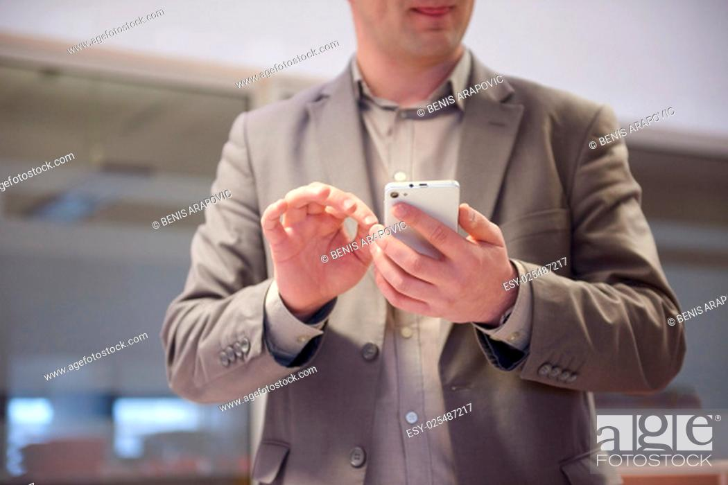Stock Photo: close up photo of business man work on phone at office.