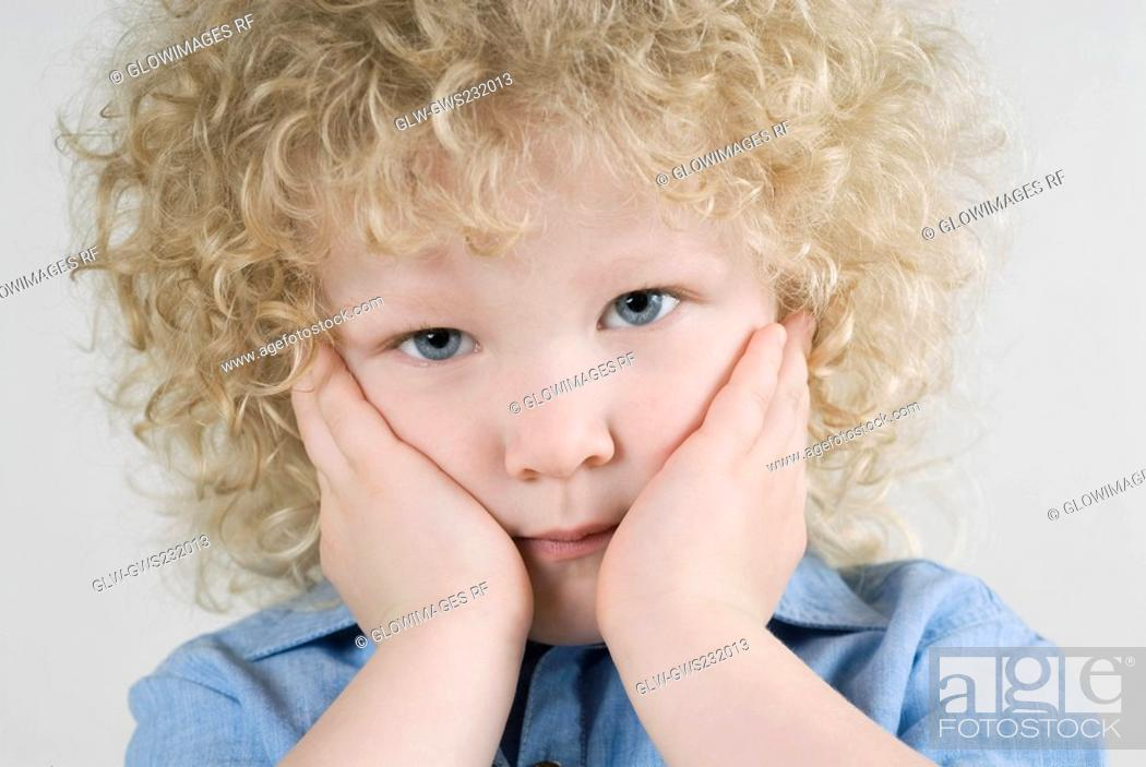 Stock Photo: Portrait of a boy thinking.