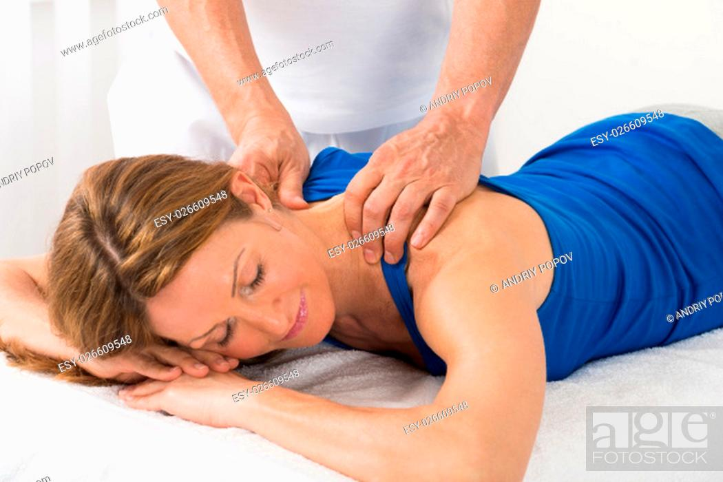 Stock Photo: Close-up Of Person Giving Massage To Mature Woman.