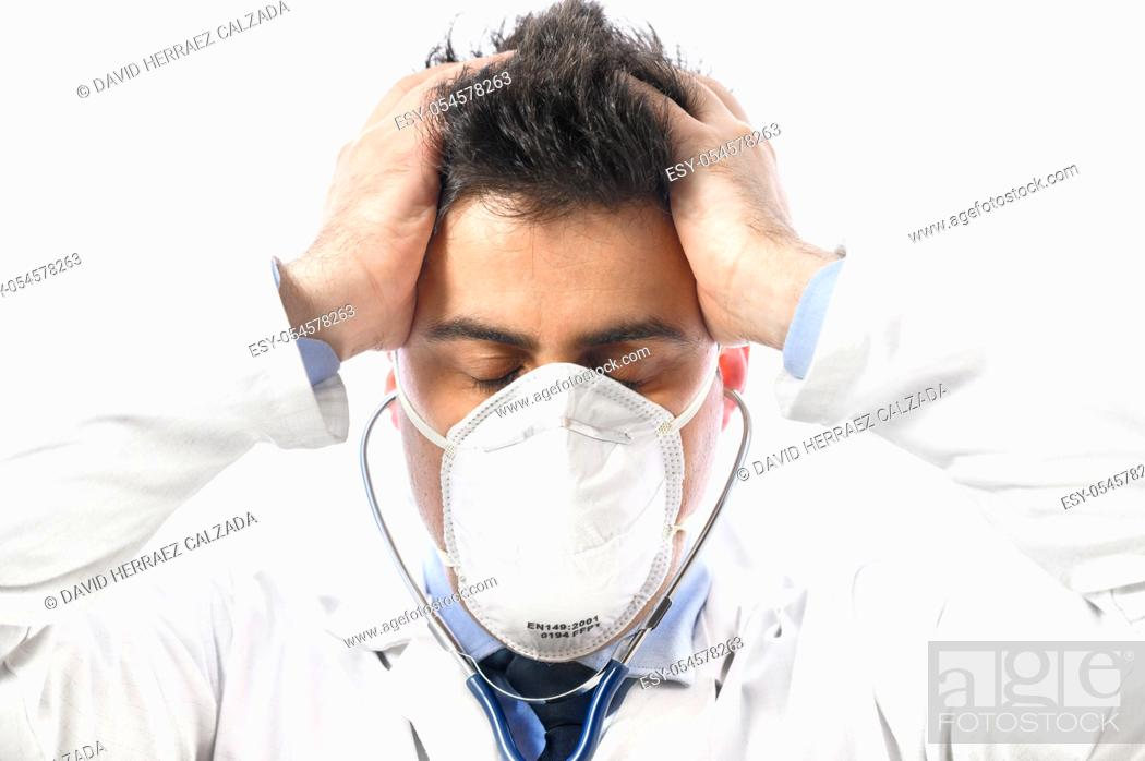 Stock Photo: Anxious and nervous doctor. Close up portrait, of a doctor in protective face mask with worried expression, whose put his hands on the head.