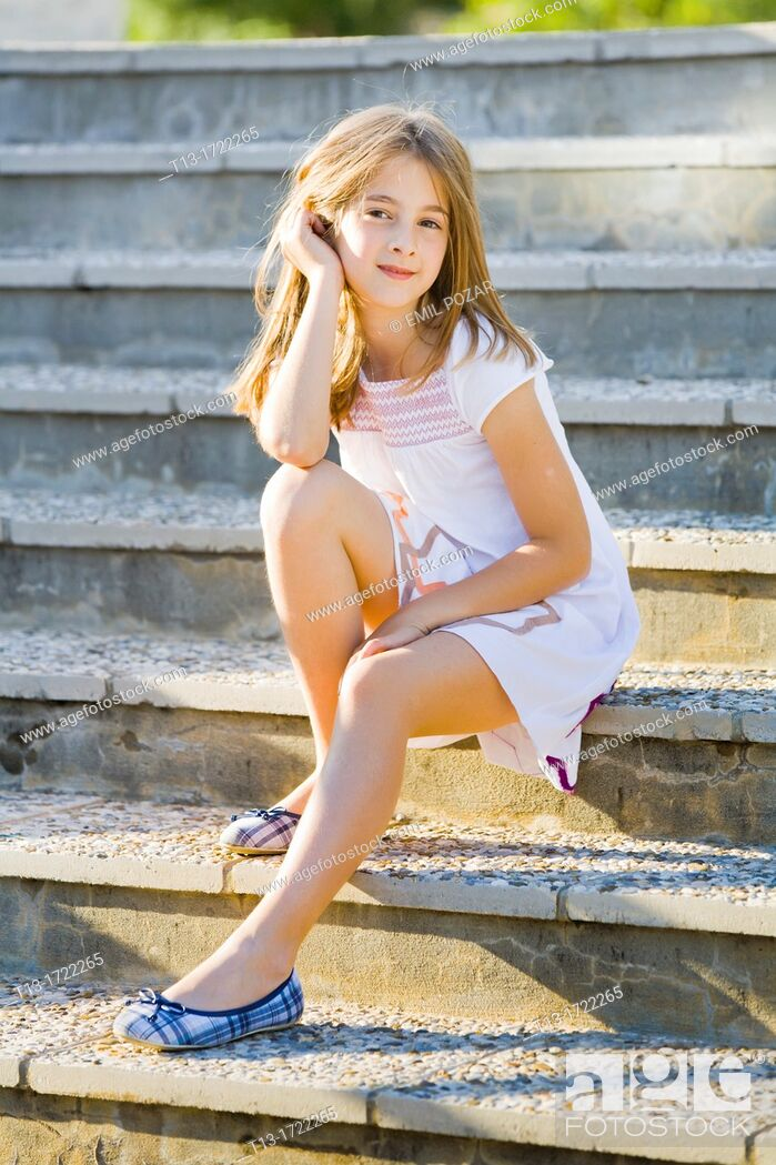 Stock Photo: Cute 8-years old girl on a staircase.