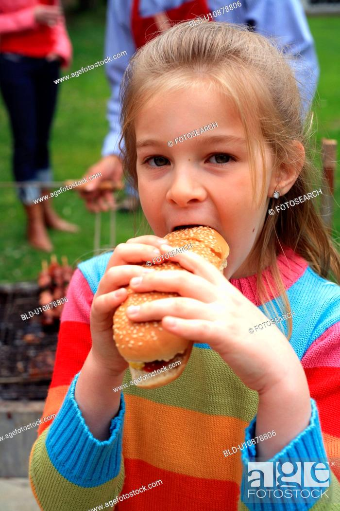 Stock Photo: Young girl eating ice cream.