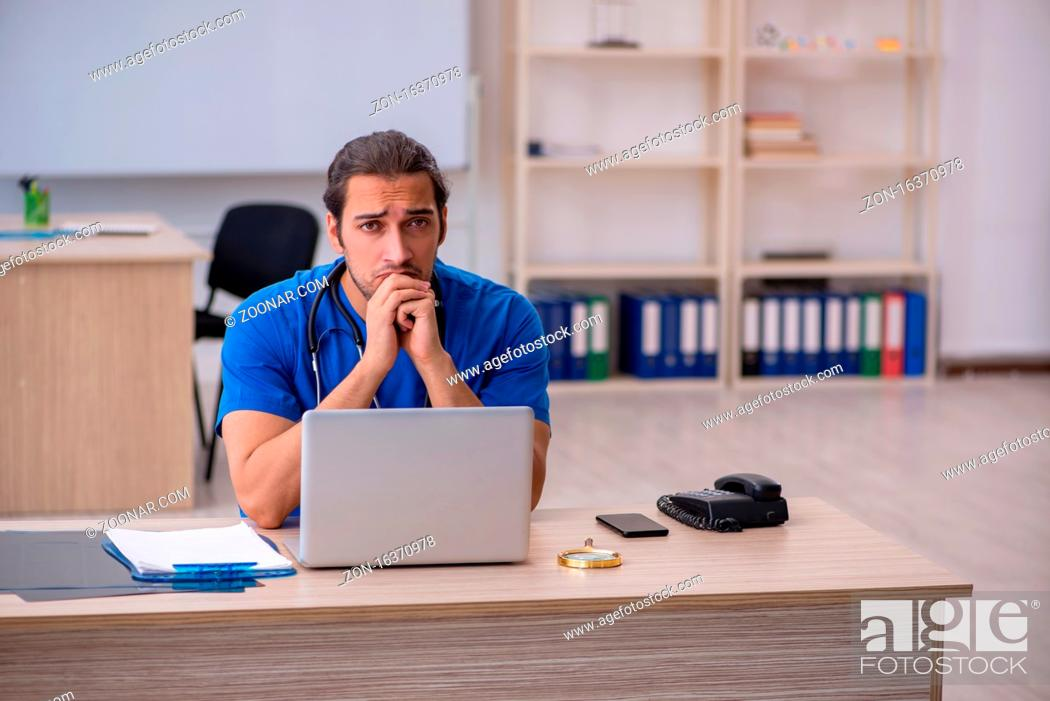 Stock Photo: Young doctor working in the clinic.