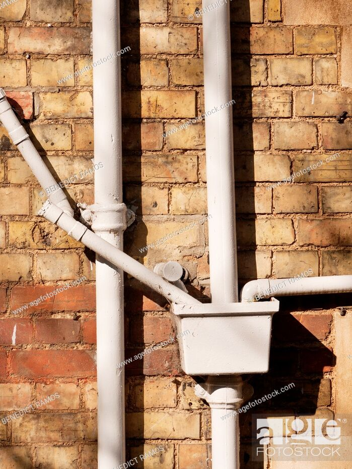 Stock Photo: Ironwork drainage pipes on Victorian building, Oxford, UK.