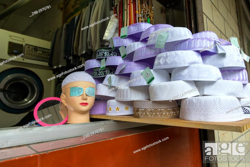Stock Photo: Muslim caps for sale in a shop, Qinghai province, Xining, China.