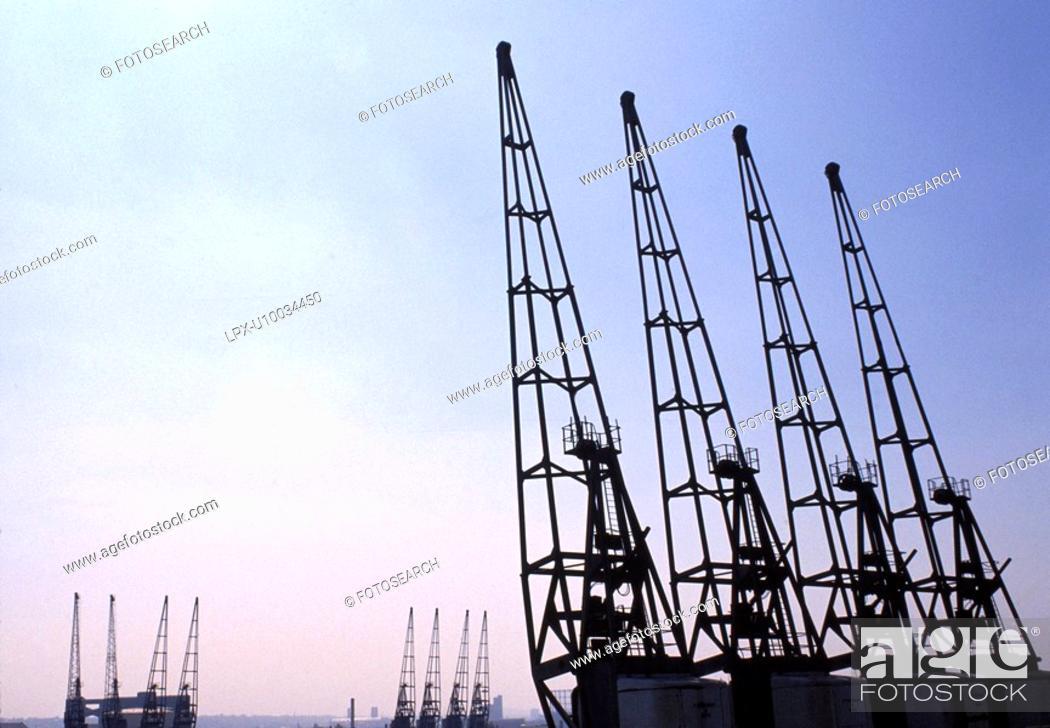 Stock Photo: Dock cranes in sunset.