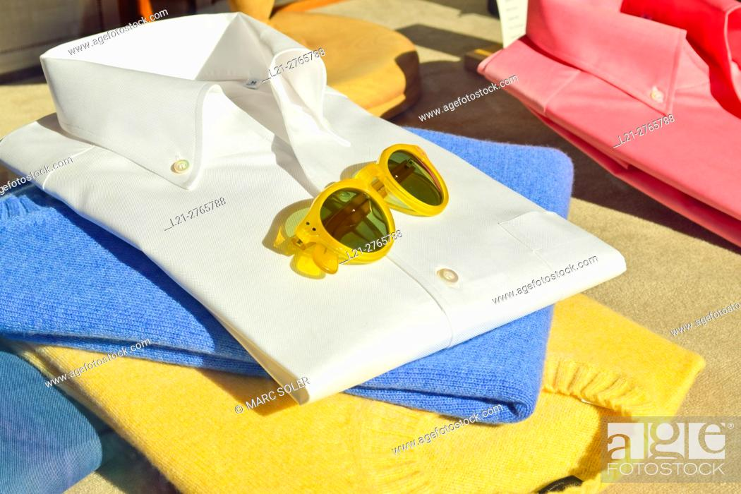 Stock Photo: Mens clothing. Shirts, jerseys, sunglass.