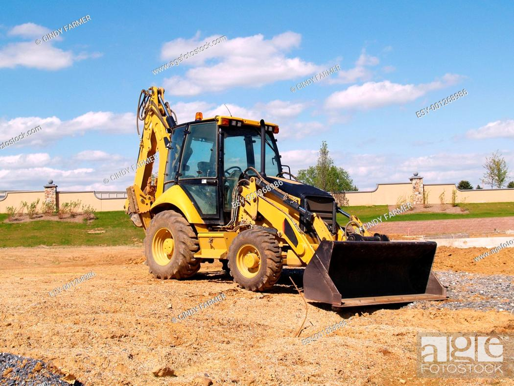 Stock Photo: front end loader at a construction site.