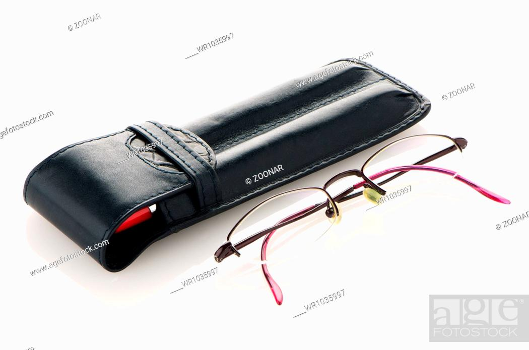 Stock Photo: Leather pencil case and glasses.