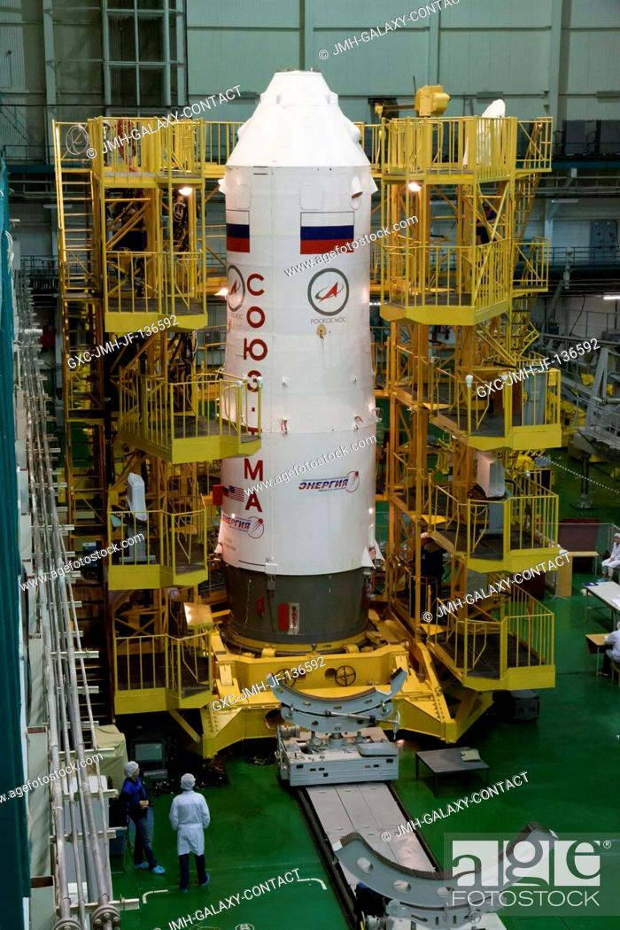 Stock Photo: With the Soyuz TMA-10M spacecraft nestled inside, the third stage of a Soyuz booster rocket stands erect in the Integration Facility at the Baikonur Cosmodrome.