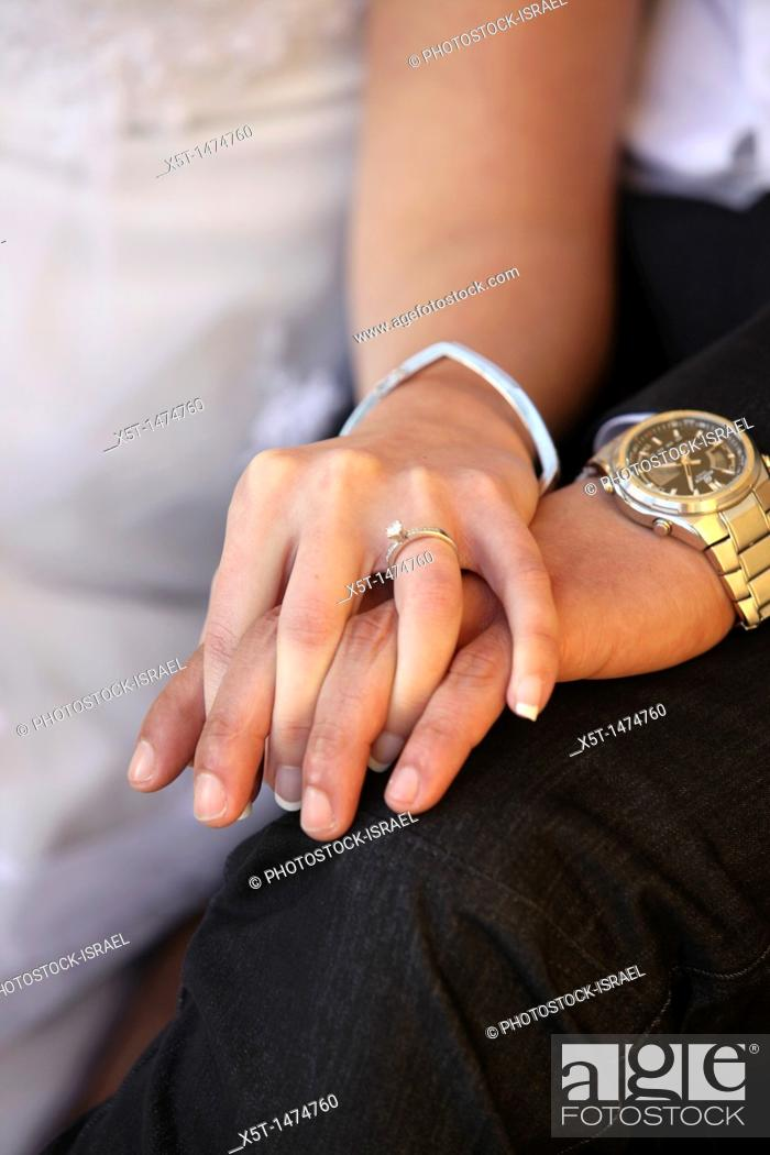 Stock Photo: Traditional Jewish Wedding bride and groom hold hands.