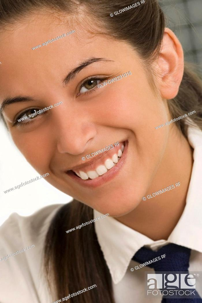 Stock Photo: Portrait of a teenage girl smiling.