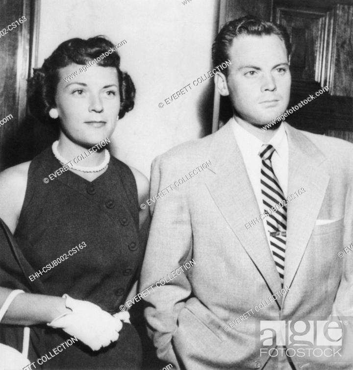 Stock Photo: Actor John Agar in court on July 20, 1950 to face to drunk driving charges. With him is his wife Loretta Barnett Combs Agar. (CSU-2015-11-1178).