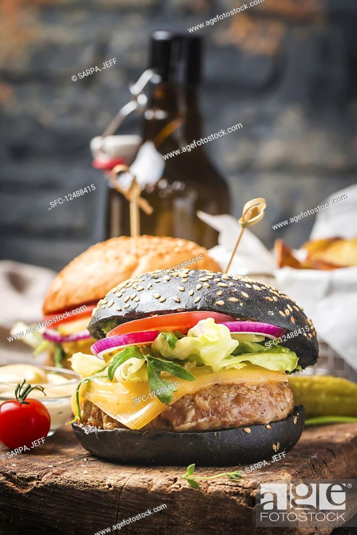 Stock Photo: Tasty grilled classic beef black burger with lettuce and mayonnaise sauce.