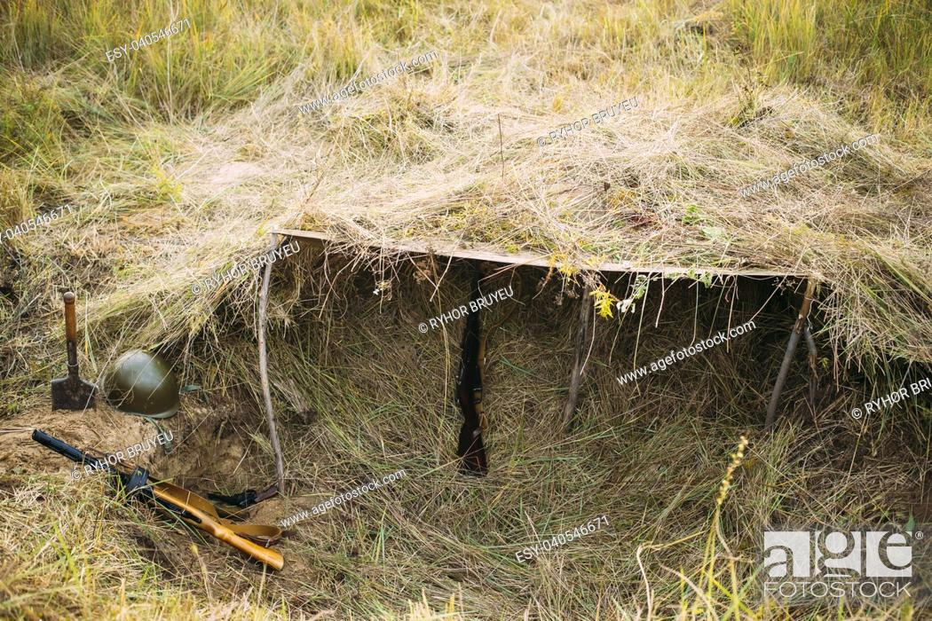 Stock Photo: Metal Helmet, Sapper Shovel And Weapons Of Infantry Soldier Of Soviet Russian Red Army During World War II, Lying Near Trench, Hovel, Ambush In Summer Meadow.