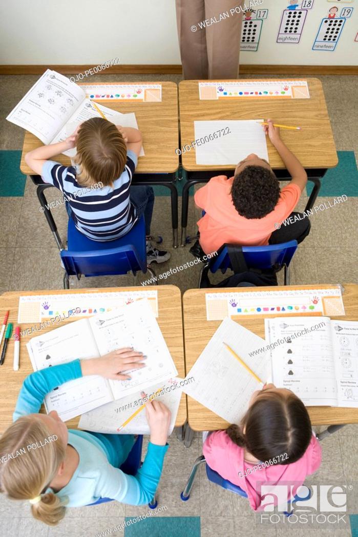 Stock Photo: Students doing school work in classroom.