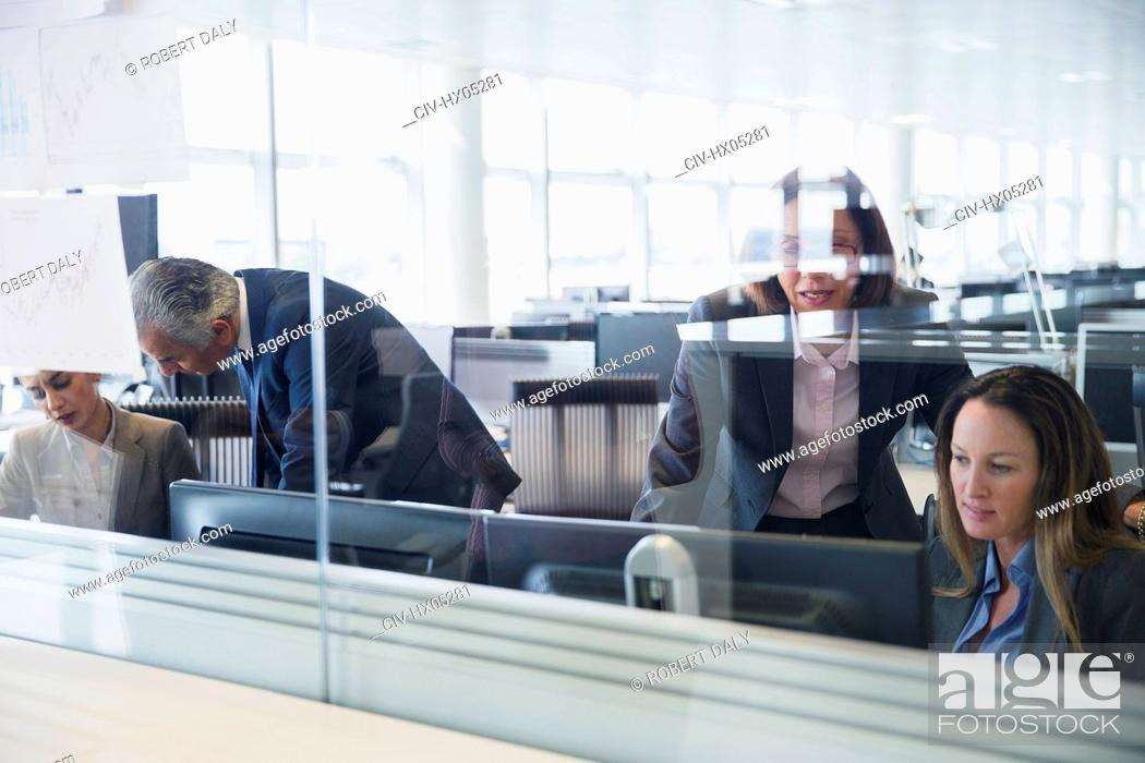 Stock Photo: Businesswomen working at computers in office.