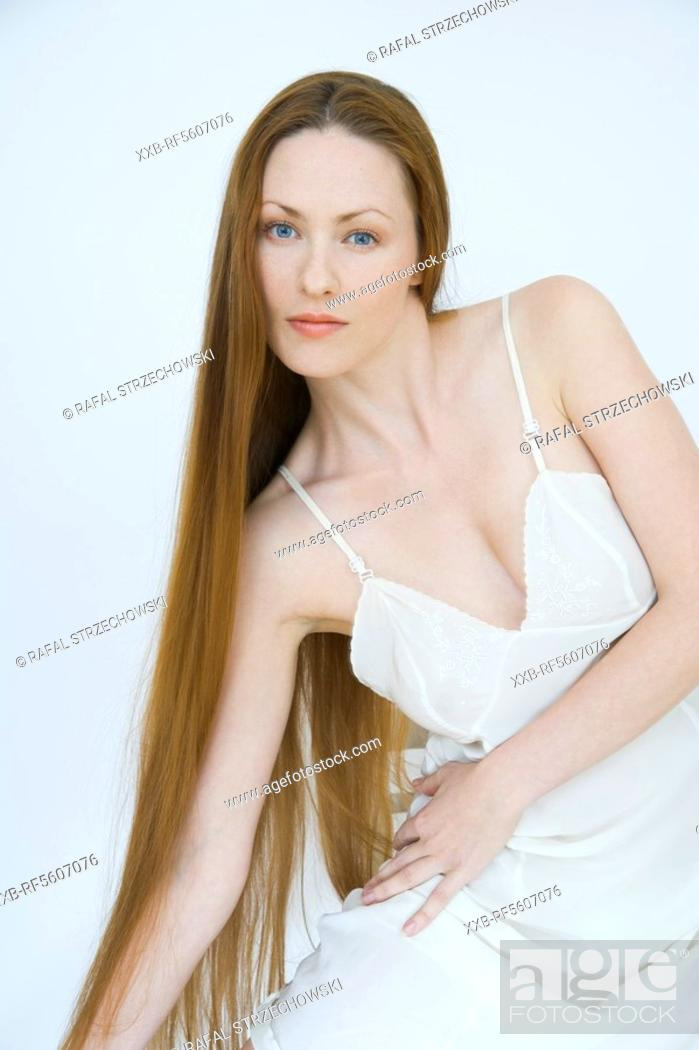 Stock Photo: young woman in white lingerie.