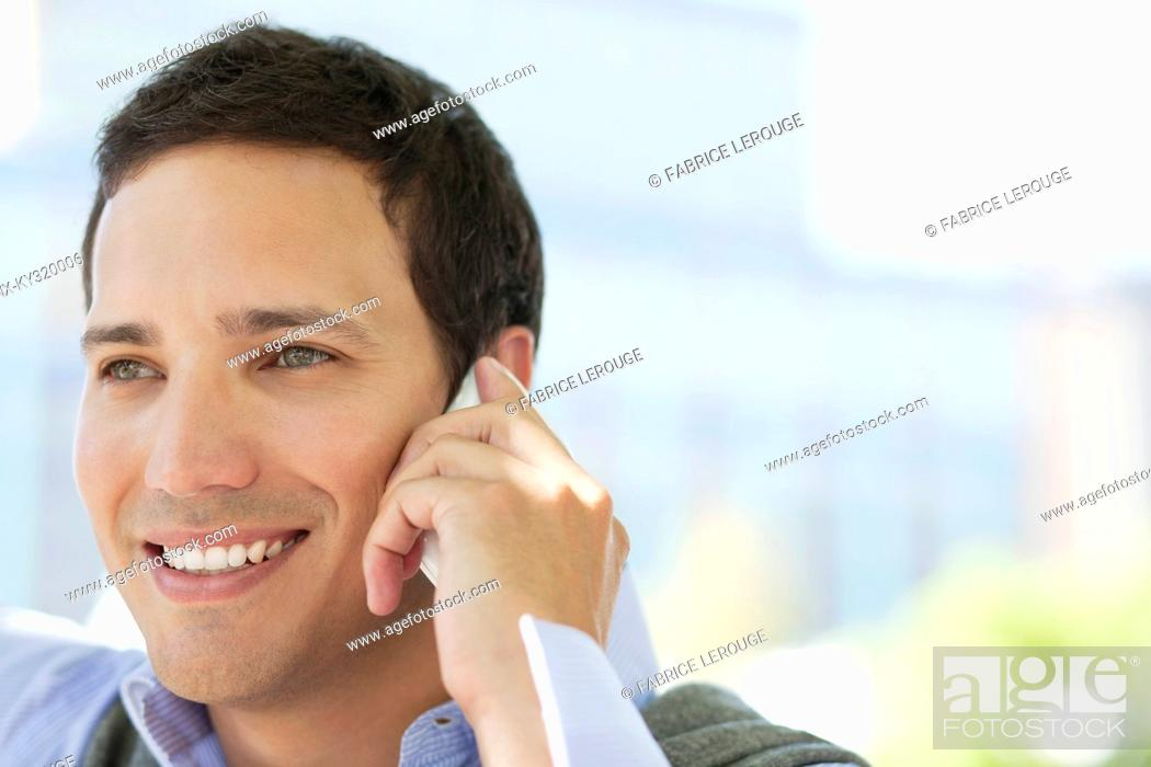 Stock Photo: Mid adult man talking on a mobile phone.