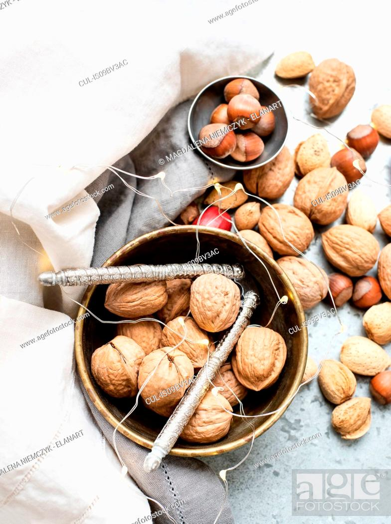 Stock Photo: Walnuts and almonds in shell, hazelnuts, ornaments.
