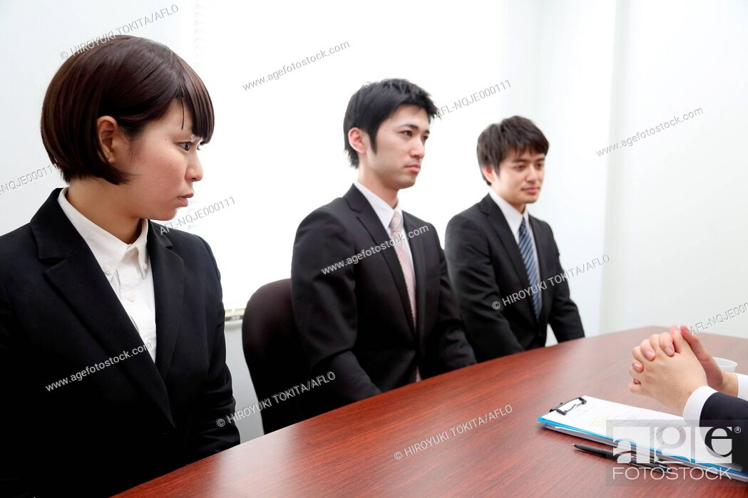 Stock Photo: Young Japanese business people work examination.