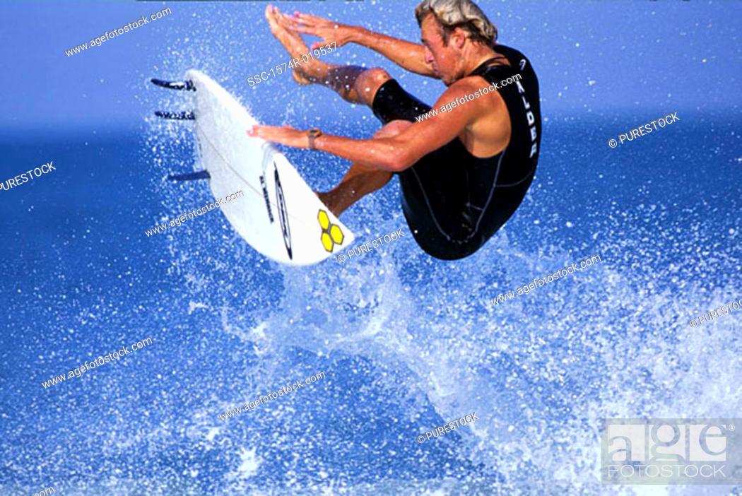 Stock Photo: Mature adult man surfing.