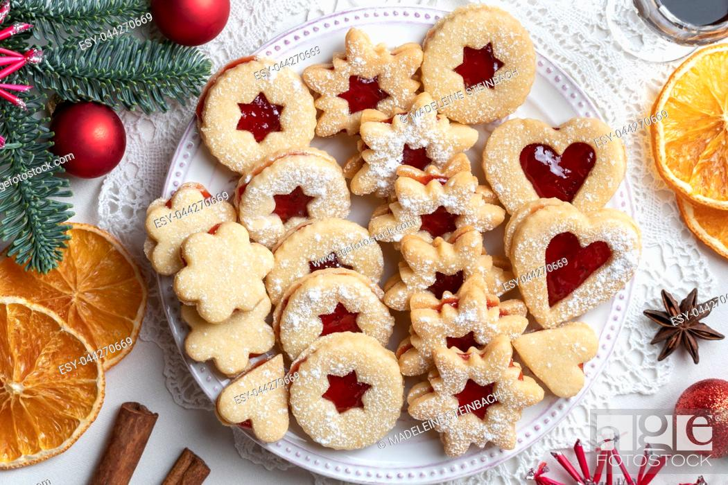Stock Photo: Traditional Linzer Christmas cookies filled with strawberry jam and dusted with sugar, top view.