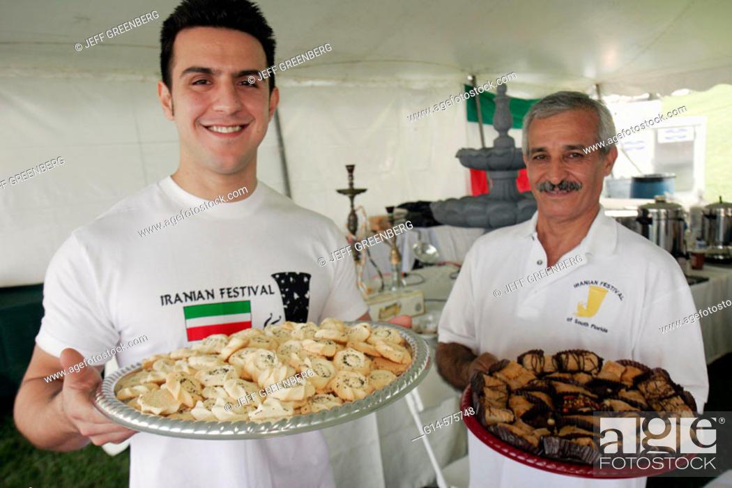 Stock Photo: Iran, Persian, men, trays, cookies, desserts, food. Iranian Festival. Bayfront Park. Miami. Florida. USA.