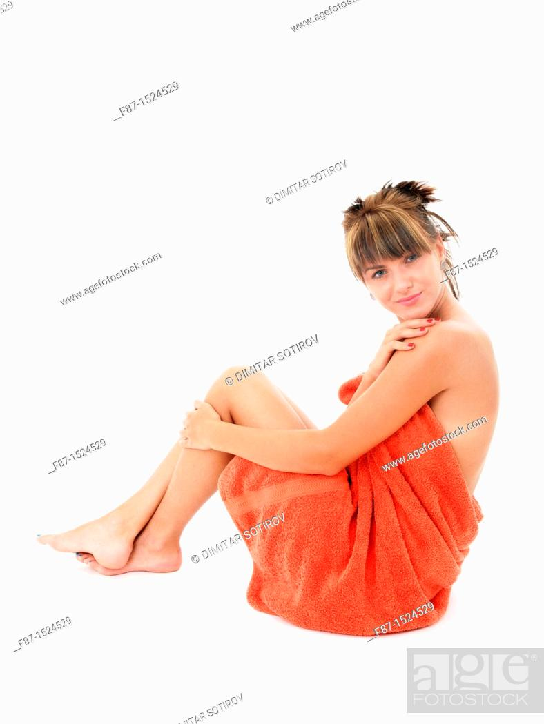 Stock Photo: Beautiful young woman in bath towel.