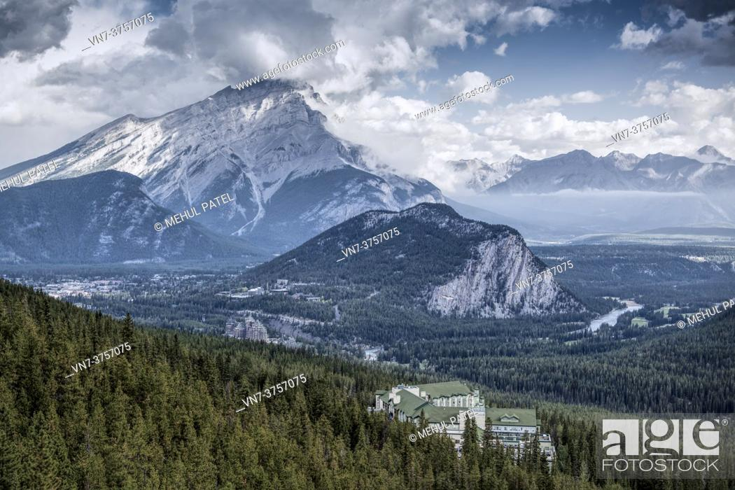 Stock Photo: View from Sulphur Mountain of the town of Banff and its surroundings area with Cascade Mountain towering above in the distance.