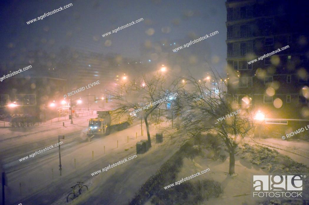 Stock Photo: Snowplows travel down Ninth Avenue in the Chelsea neighborhood of New York.