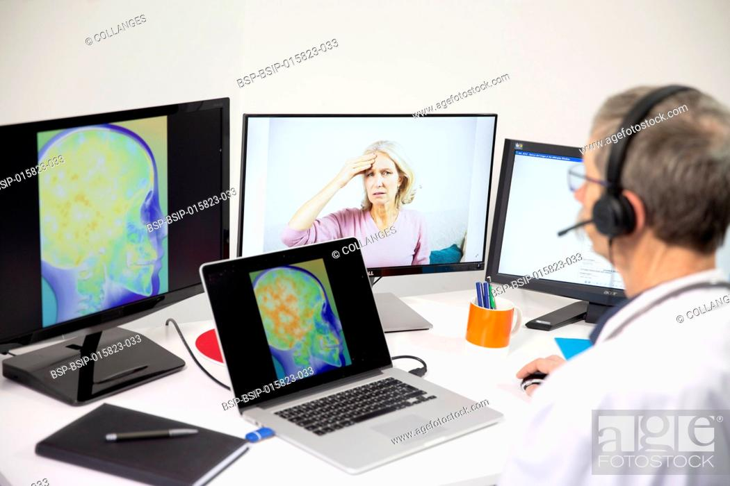 Stock Photo: A young woman having a video consultation with a male GP for head pain with brain imagery.