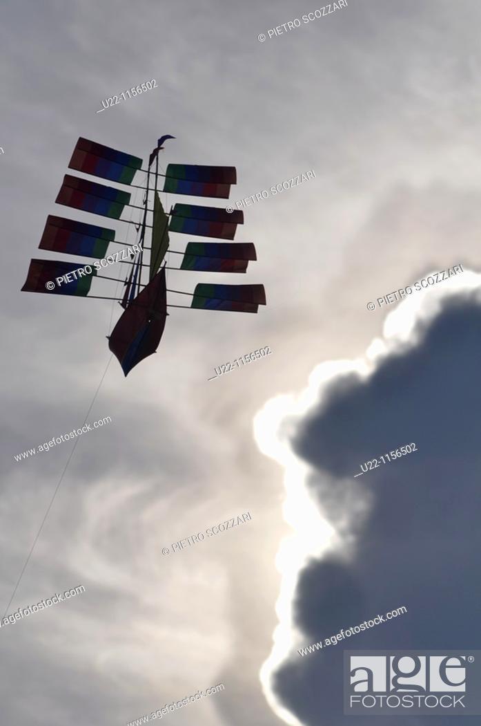 Stock Photo: Kuta Beach (Bali, Indonesia): a kite in the sky.