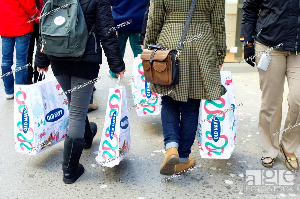 Stock Photo: Shoppers in Herald Square outside Macy's Herald Square flagship store in New York looking for bargains on Black Friday, the day after Thanksgiving, Friday.