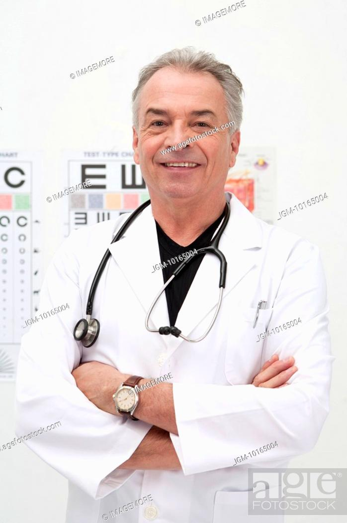 Stock Photo: Senior doctor standing with arms crossed and smiling at the camera.