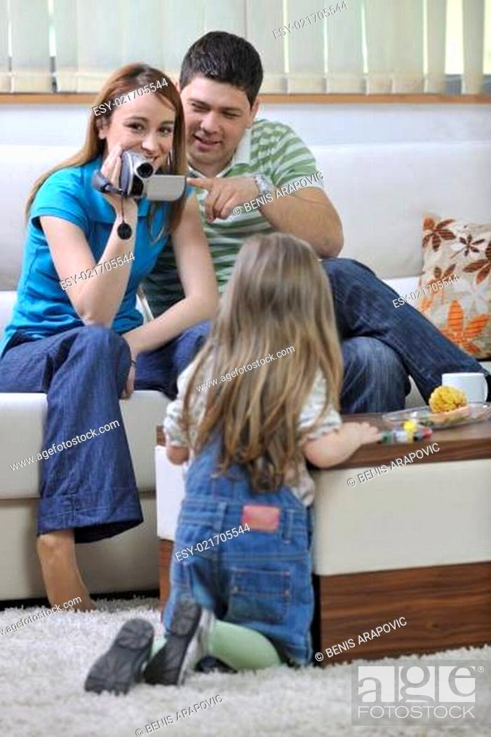 Stock Photo: happy family special moments on video.