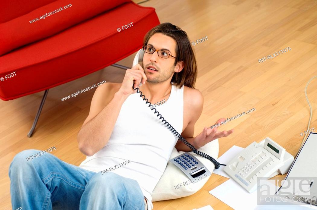 Stock Photo: Man on phone doing home finances.
