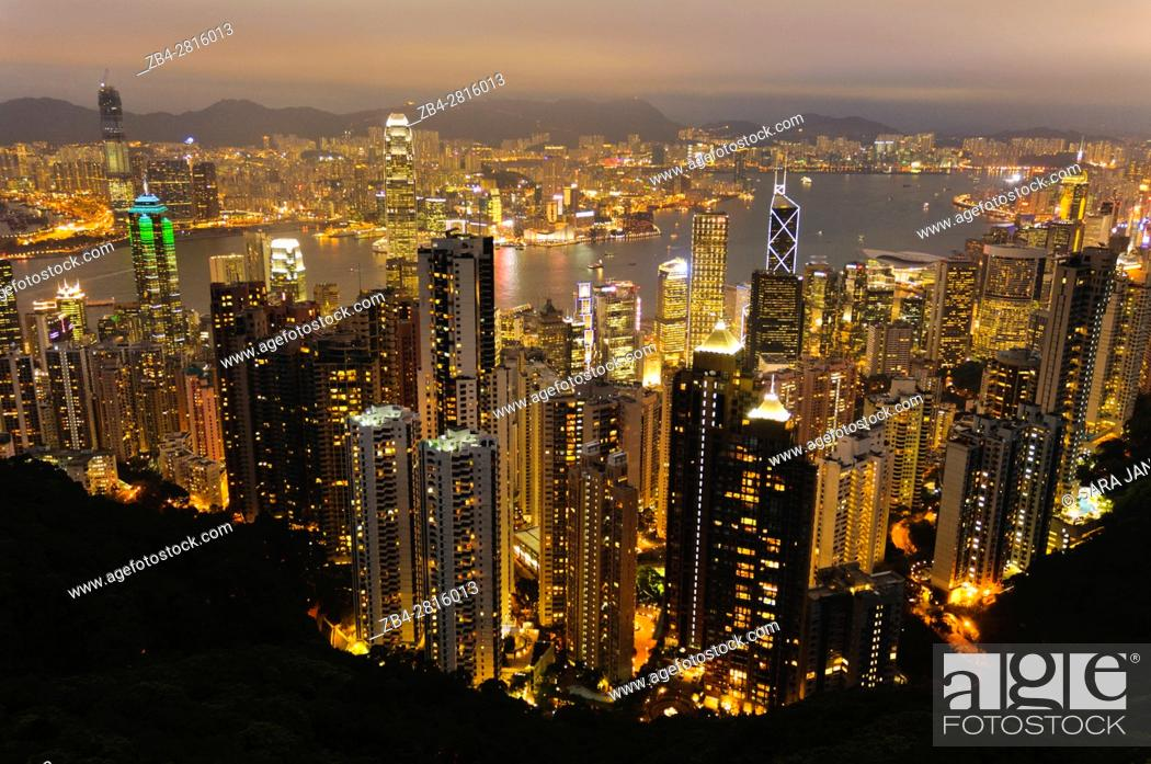 Stock Photo: Panoramic view of the city skyline at night from the summit of Victoria Peak, Hong Kong Island, Hong Kong, China, East Asia.