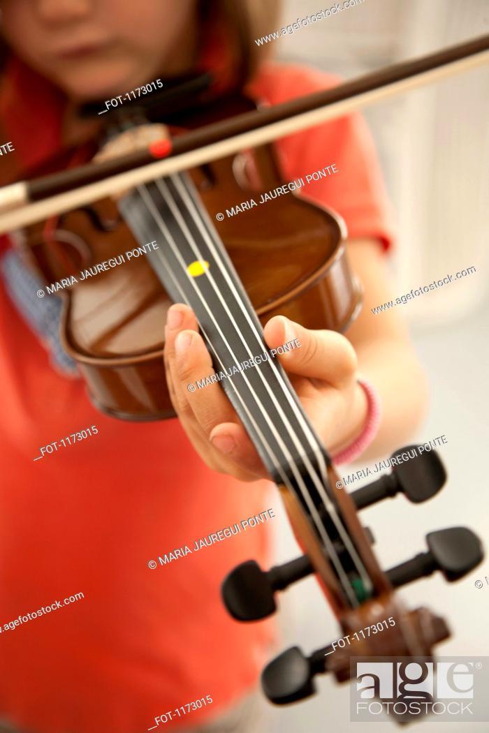 Stock Photo: Girl playing violin.