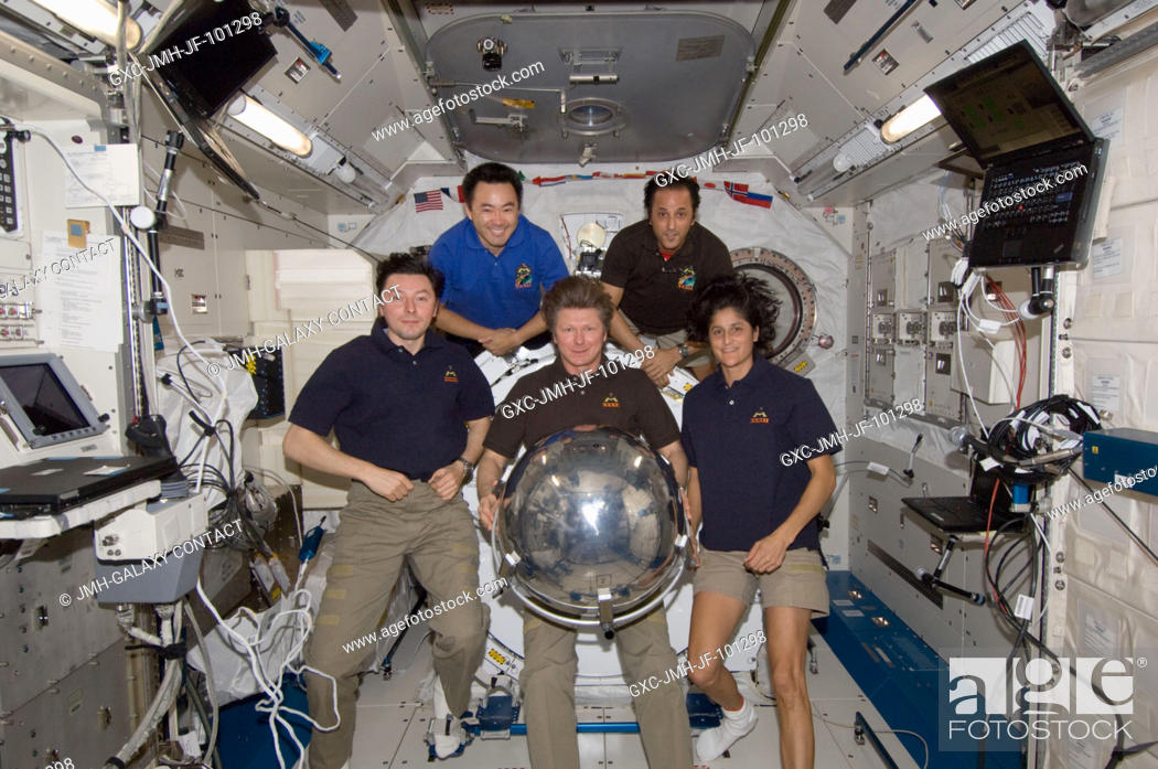 Stock Photo: Five of the six Expedition 32 crew members pose for a photo with a small ball-shaped science satellite in the Kibo laboratory of the International Space Station.