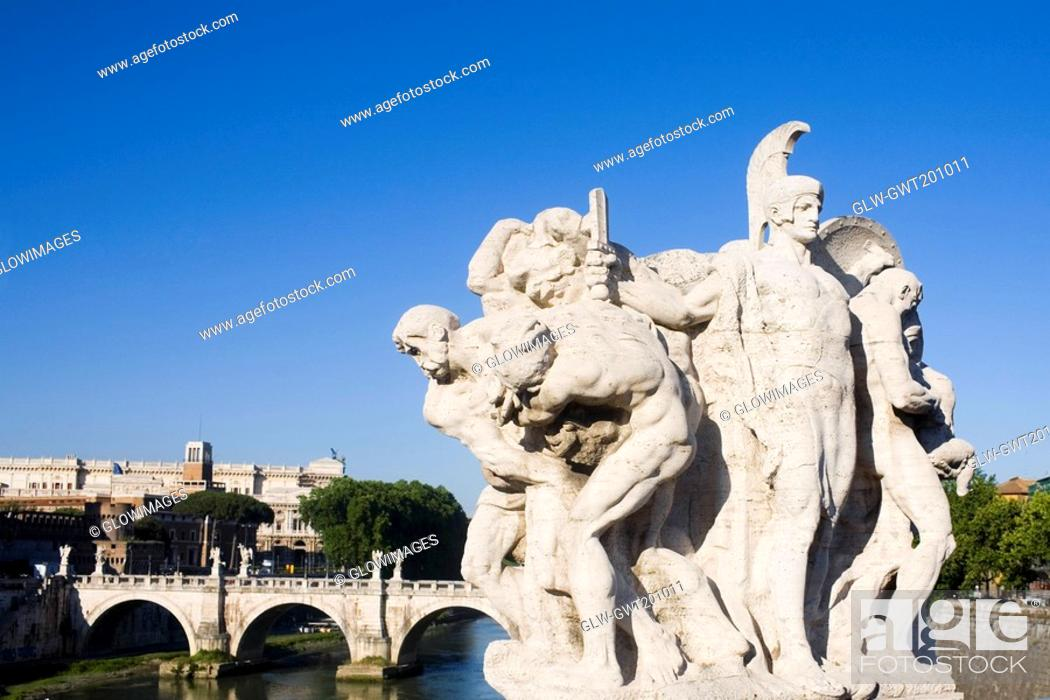 Stock Photo: Close-up of statues in front of an arch bridge, Ponte Sant Angelo, Tiber River, Rome, Italy.