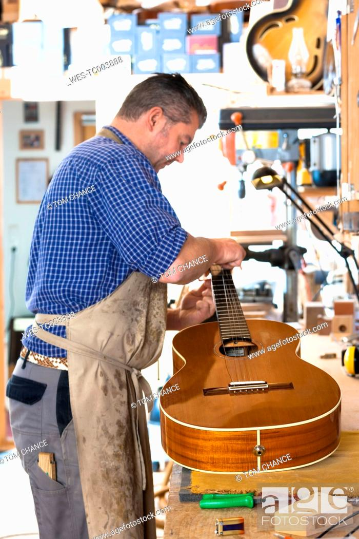Stock Photo: Guitar maker in his workshop.